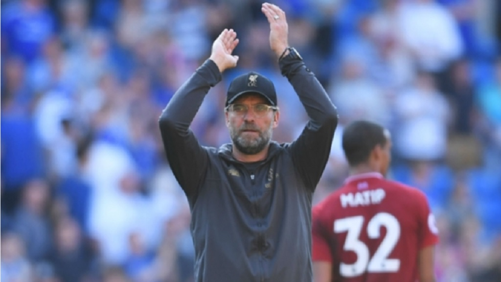 Liverpool boss Jurgen Klopp applauds the travelling fans.