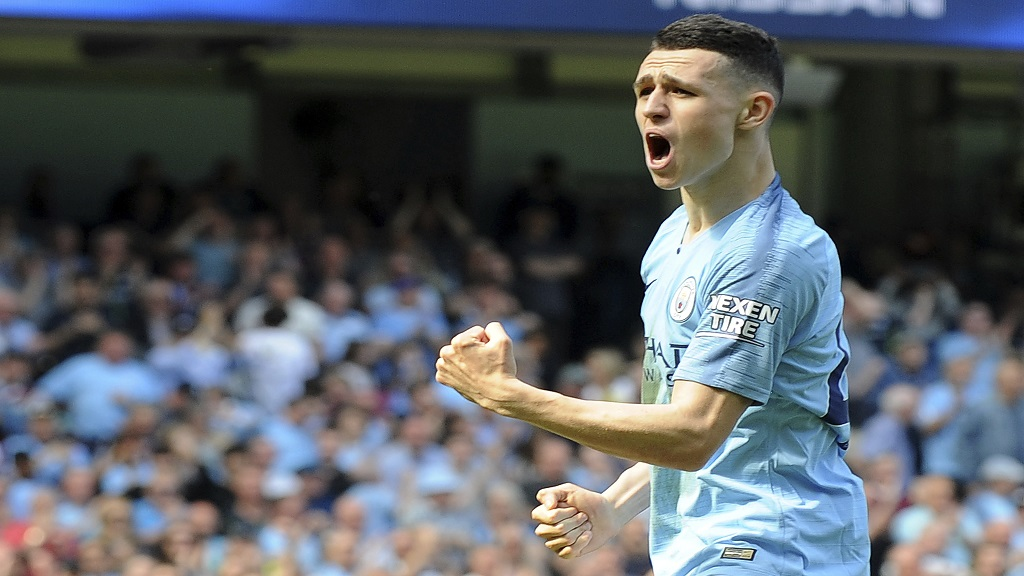 Manchester City's Phill Foden celebrates his goal against Tottenham during the English Premier League football match against Tottenham Hotspur at Etihad stadium in Manchester, England, Saturday, April 20, 2019.
