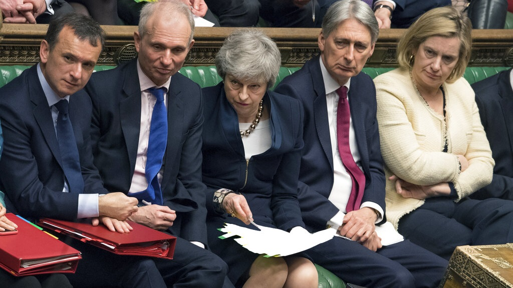 In this photo provided by the UK Parliament, Britain's Prime Minister Theresa May, center, in the Palace of Westminster in London, Wednesday, April 3, 2019.  (Mark Duffy/UK Parliament via AP)