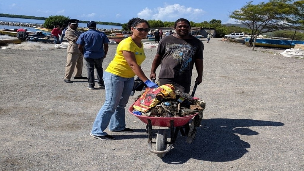 Lisa Belnavis, Human Resources Manager at Food For The Poor – Jamaica (left) and Michael Latchman, Secretary at Hunts Bay Fisherfolk Benevolent Society.