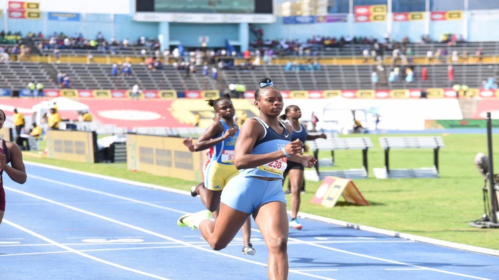 Kevona Davis of        Edwin Allen High  wins semi-final 1 of the Girls' Class 2 100m at the 2019 ISSA/GraceKennedy Boys' and Girls' Athletics Championships at the National Stadium on Friday, March 29, 2019.