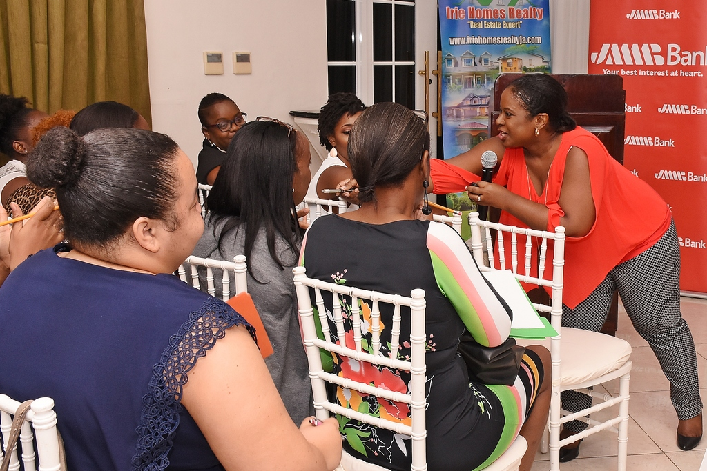 Michelle Sinclair Doyley, Manager, Client Financial Education, JMMB, interacts with participants during her presentation on Financial Goal Planning at the recently held 'Boss Lady, Let's Talk Wealth! 'event at Eden Gardens Wellness Resort & Spa.