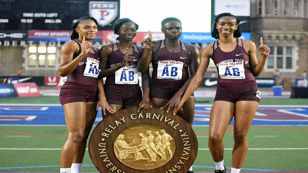 Members of Holmwood Technical's 4x400m team following their championship victory in heavy downpour at the Penn Relays Carnival on April 26, 2019.