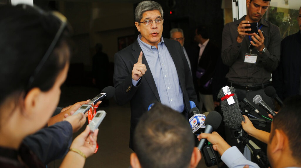 In this Dec. 12, 2018, file photo, Cuba's Director-General of U.S. Affairs Carlos Fernandez de Cossio makes a statement to reporters, in Havana, Cuba. De Cossio says his nation has no troops in Venezuela but it maintains the right to military and intelligence cooperation with its ally. (AP Photo/Desmond Boylan, File)