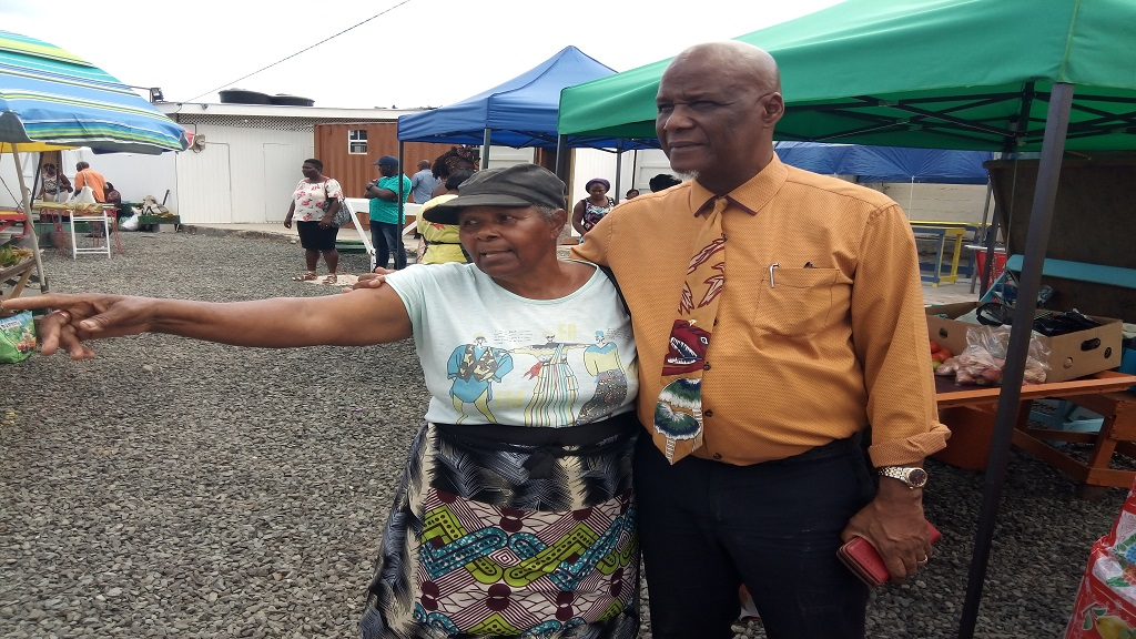 Mayor Francis with a vendor Monday morning at the relocation site