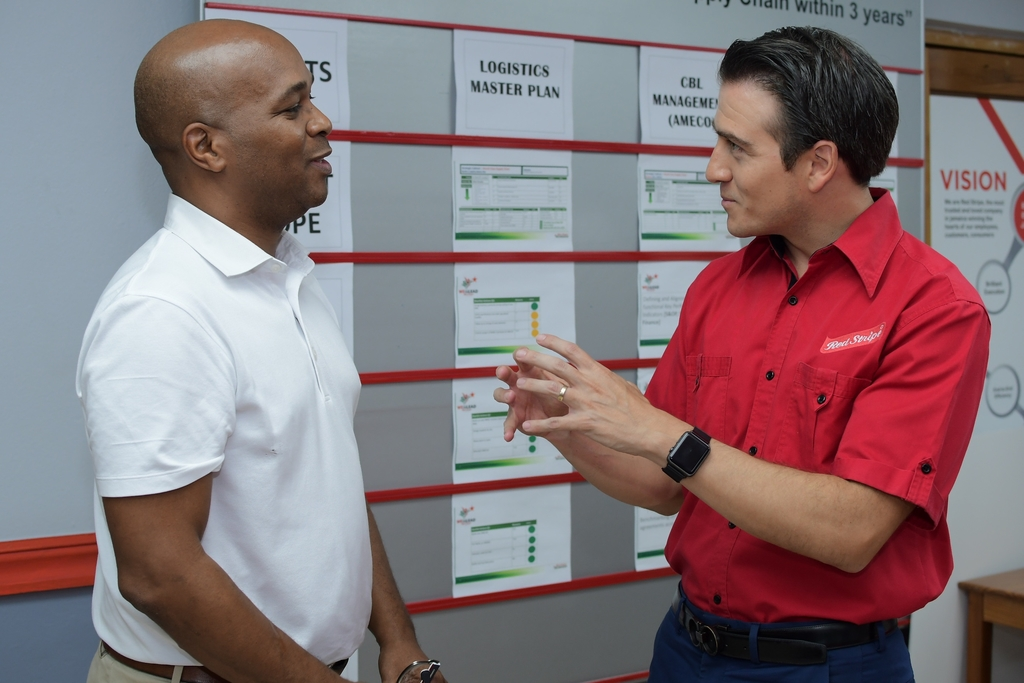 Ricardo Nuncio (right), Managing Director, Red Stripe speaks with Stephen Dawkins, JMEA Vice President - Export and Logistics Committee at an Export Peer Share hosted by the brewing company.