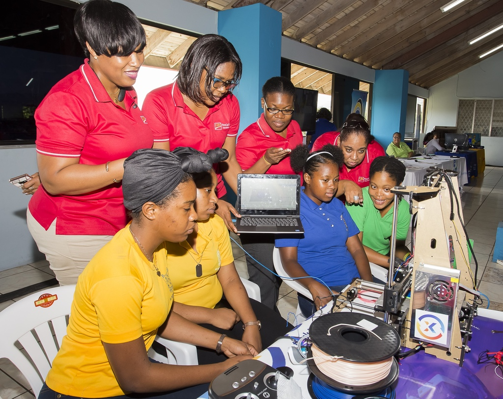 The CIBC FirstCaribbean International Bank team (in red back row) with participants in the CARIBBEAN.GIRLS.HACK – 2019 Hackathon at the Chinese Benevolent Association on May 14, 2019