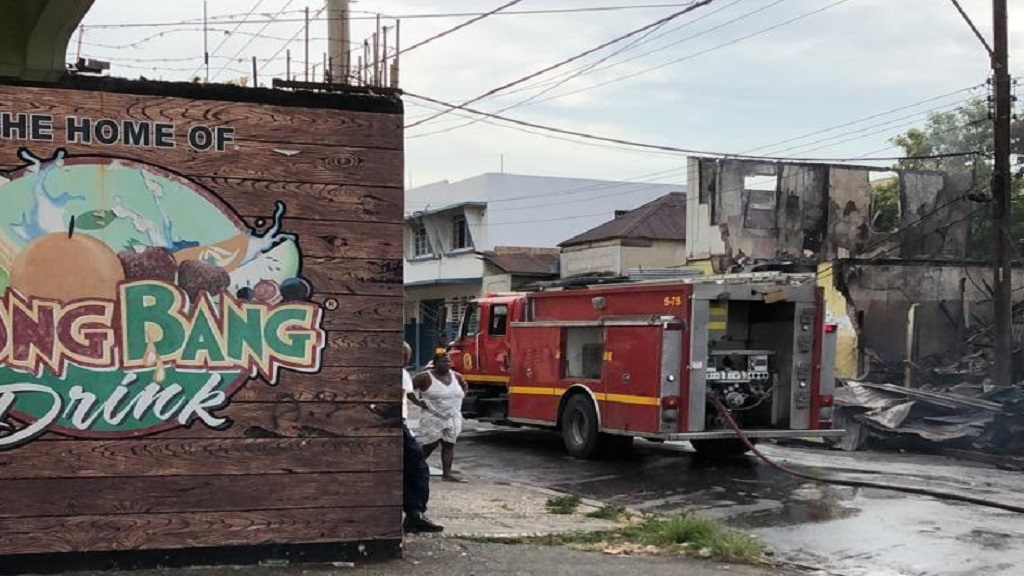 A fire unit and residents on the scene of a fire which destroyed several buildings on Orange Street in downtown Kingston on Wednesday night into Thursday morning.