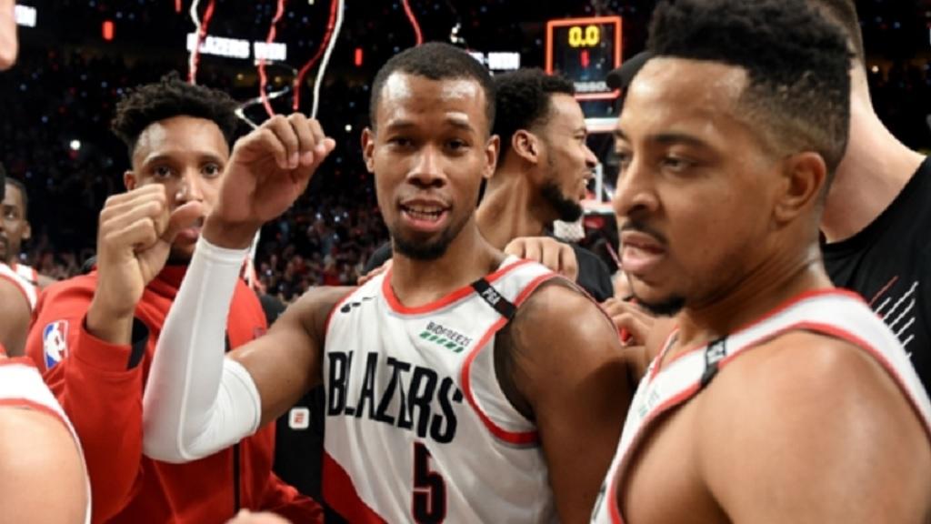 The Trail Blazers celebrate Rodney Hood's game-winning three.