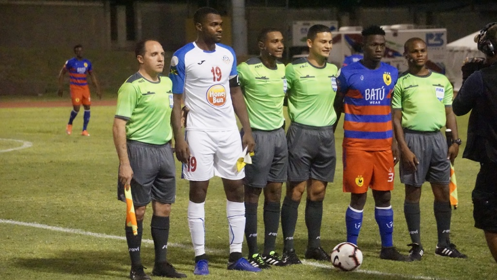 Portmore United captain Rosario Harriott (far left # 19) will have the rare distinction of leading his club to unprecedented heights --- a spot in the prestigious Scotiabank Concacaf Champions League (SCCL).