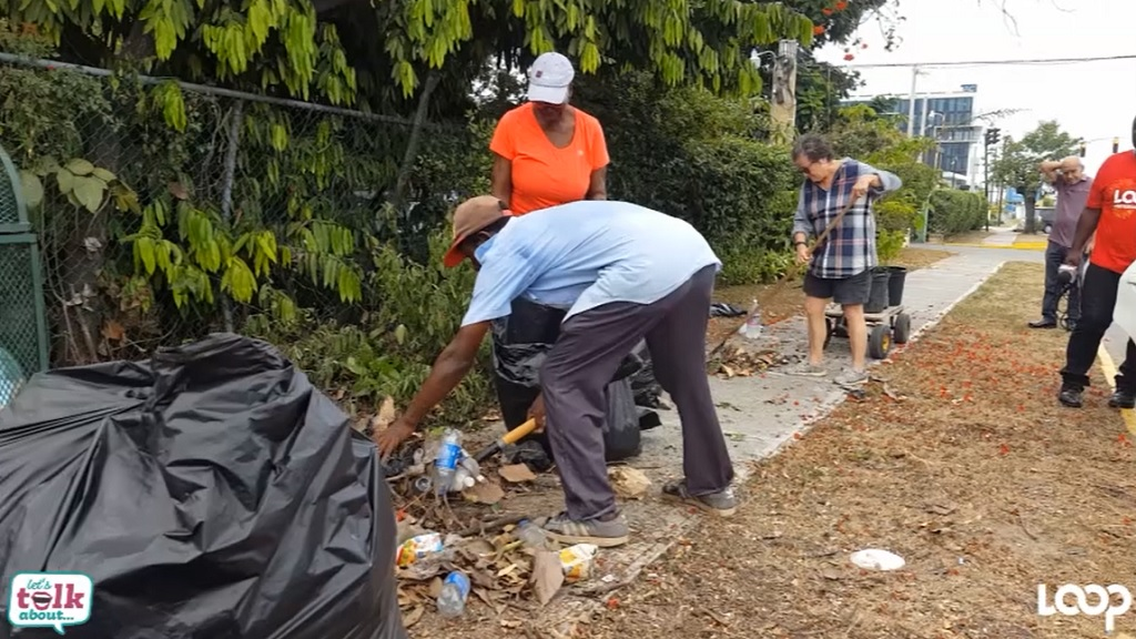 Volunteers participate in a clean-up exercise in St Andrew on Thursday.