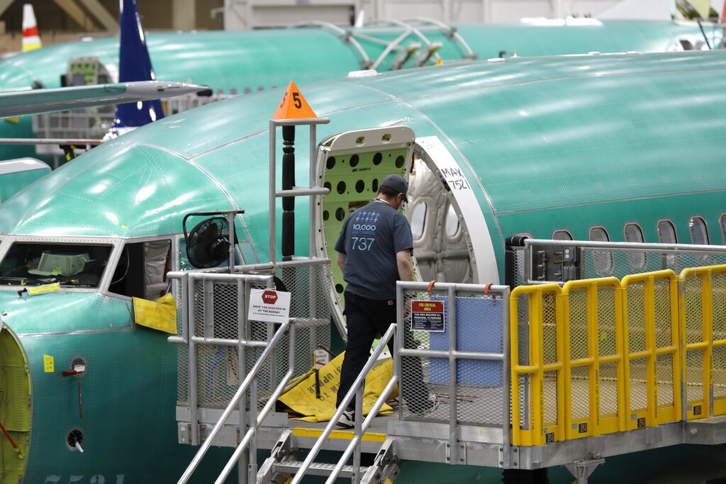 This March 27, 2019, file photo shows a Boeing 737 MAX 8 airplane on the assembly line during a brief media tour of Boeing's 737 assembly facility in Renton, Wash.  (AP Photo/Ted S. Warren, File)