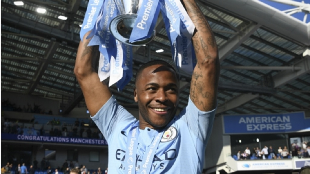 Raheem Sterling celebrates Manchester City's title.