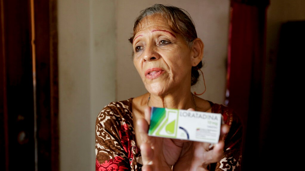 Bertha Dun shows medicine bought with cryptocurrency through online transfers, in Barquisimeto, Venezuela, Thursday, April 11, 2019. Venezuela's political and economic crisis has now made it a prime testing ground using cryptocurrency to finance social projects or send relief directly to people living in poverty. (AP Photo/Manuel Rueda)