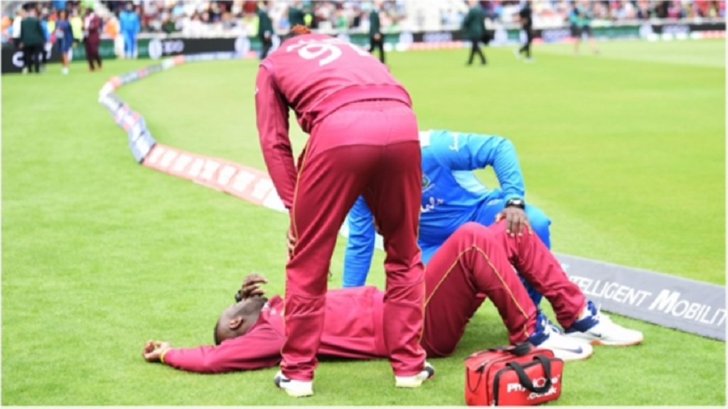 Andre Russell receives treatment at Trent Bridge.