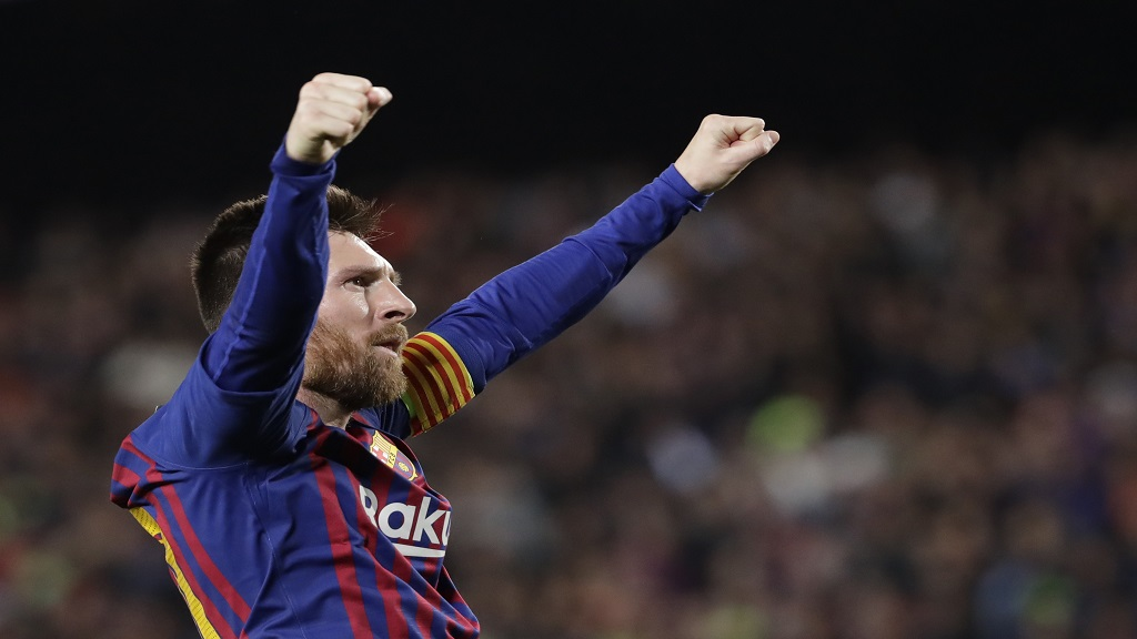 Barcelona's Lionel Messi celebrates after scoring his side's third goal during the Champions League semifinal, first leg, football match against Liverpool at the Camp Nou stadium in Barcelona, Spain, Wednesday, May 1, 2019.