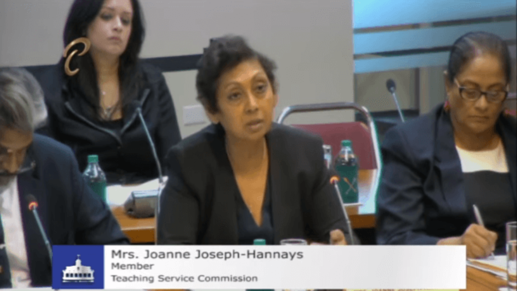 Teaching Service Commission Member Joanne Joseph-Hannays peaks during a Joint Select Committee meeting inquiring into sexual harassment by teachers against students.