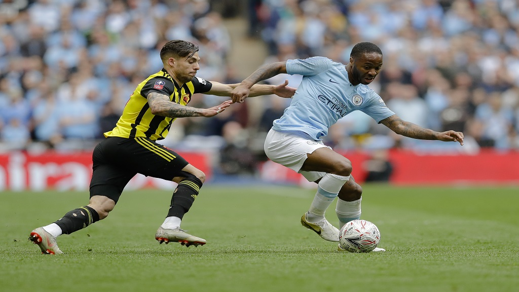 Manchester City's Raheem Sterling, right, challenges for the ball with Watford's Kiko Femenia during the English FA Cup Final soccer match between Manchester City and Watford at the Wembley stadium in London, Saturday, May 18, 2019.