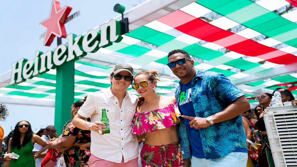 (from left) Ricardio Nuncio, Managing Director of  Red Stripe and his wife, Abigail Nuncio seen here with the vibes starter ZJ Bambino at the Sunnation Sunrise Breakfast Party.