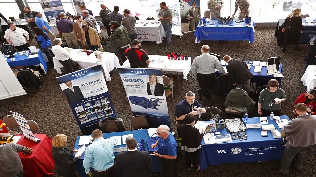 Visitors to the Pittsburgh veterans job fair meet with recruiters at Heinz Field in Pittsburgh. (AP Photo)