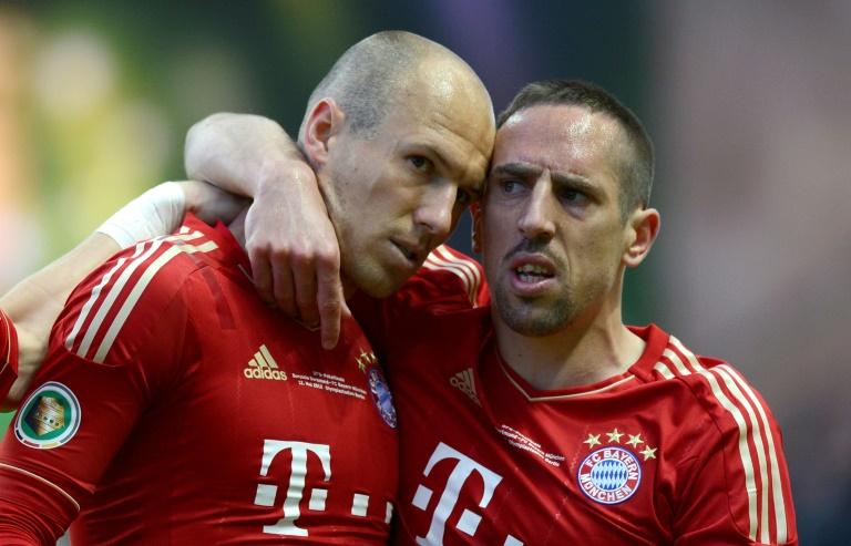 Les joueurs du Bayern Munich Franck Ribéry et Arjen Robben lors de la victoire à domicile 5-1 face à Francfort en dernière journée du championnat d'Allemagne le 18 mai 2019