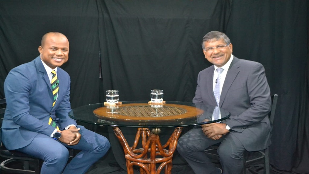 George Davis (left) with British High Commissioner to Jamaica, Asif Ahmad, on the set of 'The Conversation'.