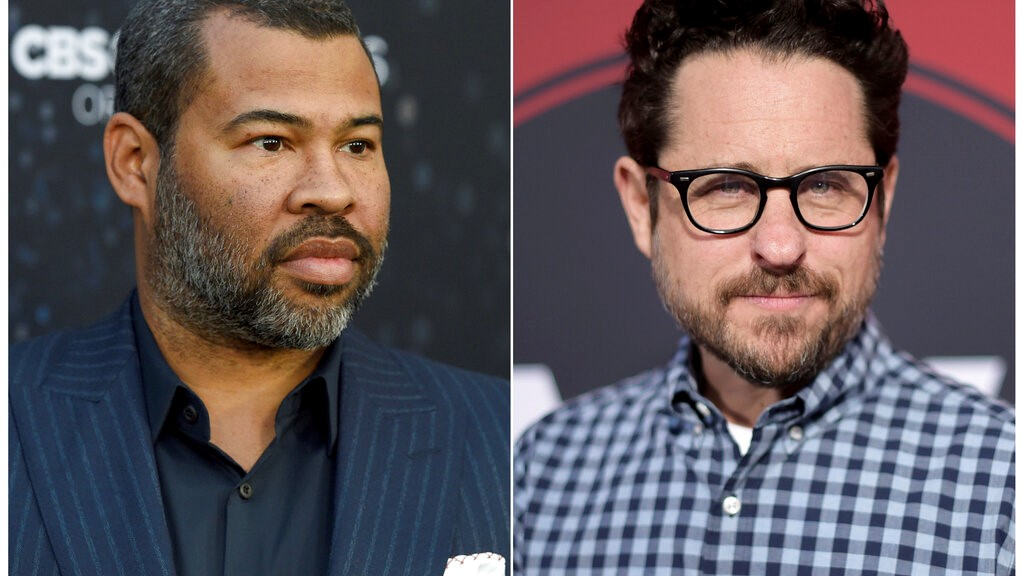 "This combination of photos shows Jordan Peele at the Los Angeles premiere of ""The Twilight Zone"" on March 26, 2019, left, and J.J. Abrams at the Los Angeles premiere of ""Westworld"" Season Two, on April 16, 2018.  (Photos by Chris Pizzello, left, Richard Shotwell/Invision/AP)"