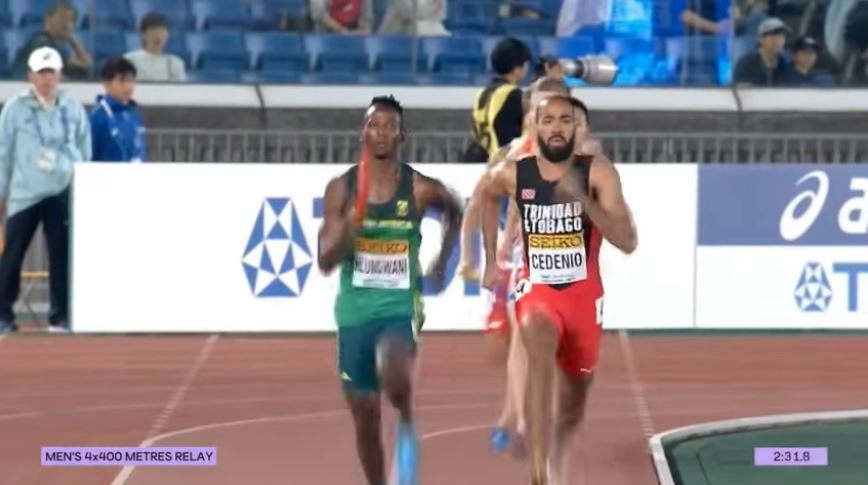 Machel Cedenio finishing the last leg of the Men's 4 x 400m relay heat.