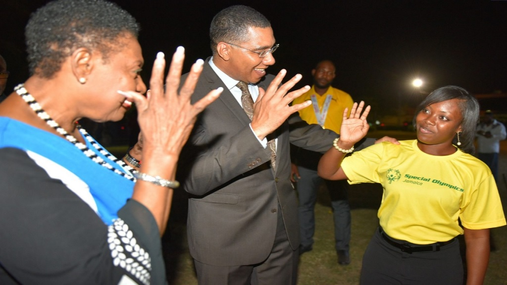 Prime Minister  Andrew Holness (centre), and Sports Minister  Olivia Grange (right), applaud Chrystal Allen in sign language, on her silver medal in unified soccer, representing Jamaica at the 2019 Special Olympics in Abu Dhabi, United Arab Emirates, from March 14 to 21. The occasion was a reception held in honour of the Special Olympians at Jamaica House on May 3, 2019.