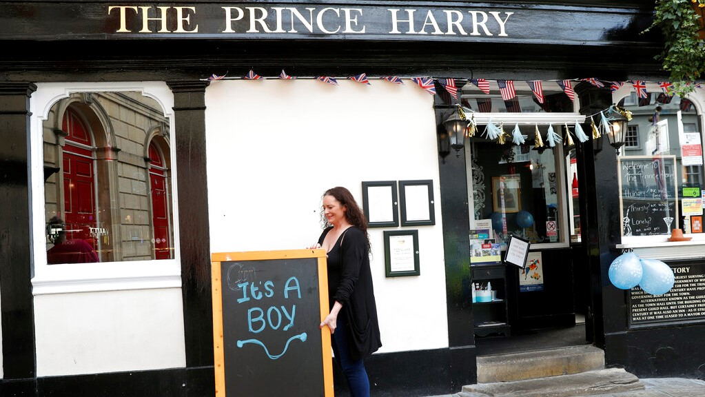 A publican displays a board outside the Prince Harry pub, in Windsor, south England, Tuesday, May 7, 2019, a day after Prince Harry announced that his wife Meghan, Duchess of Sussex, had given birth to a boy. (AP Photo/Alastair Grant)