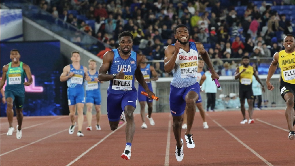 Jamaica's anchor leg runner Nigel Ellis (right) struggles behind in the final of the men's 4x100m at the IAAF World Relays in Yokohama on Sunday, May 12, 2019.
