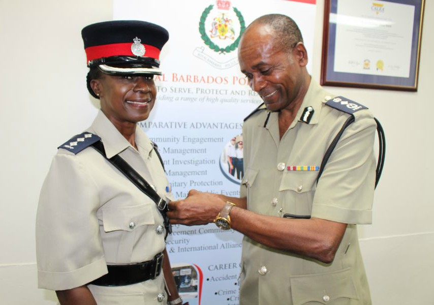 Inspector Christine Standford receiving her award from Police Commissioner, Tyrone Griffith.