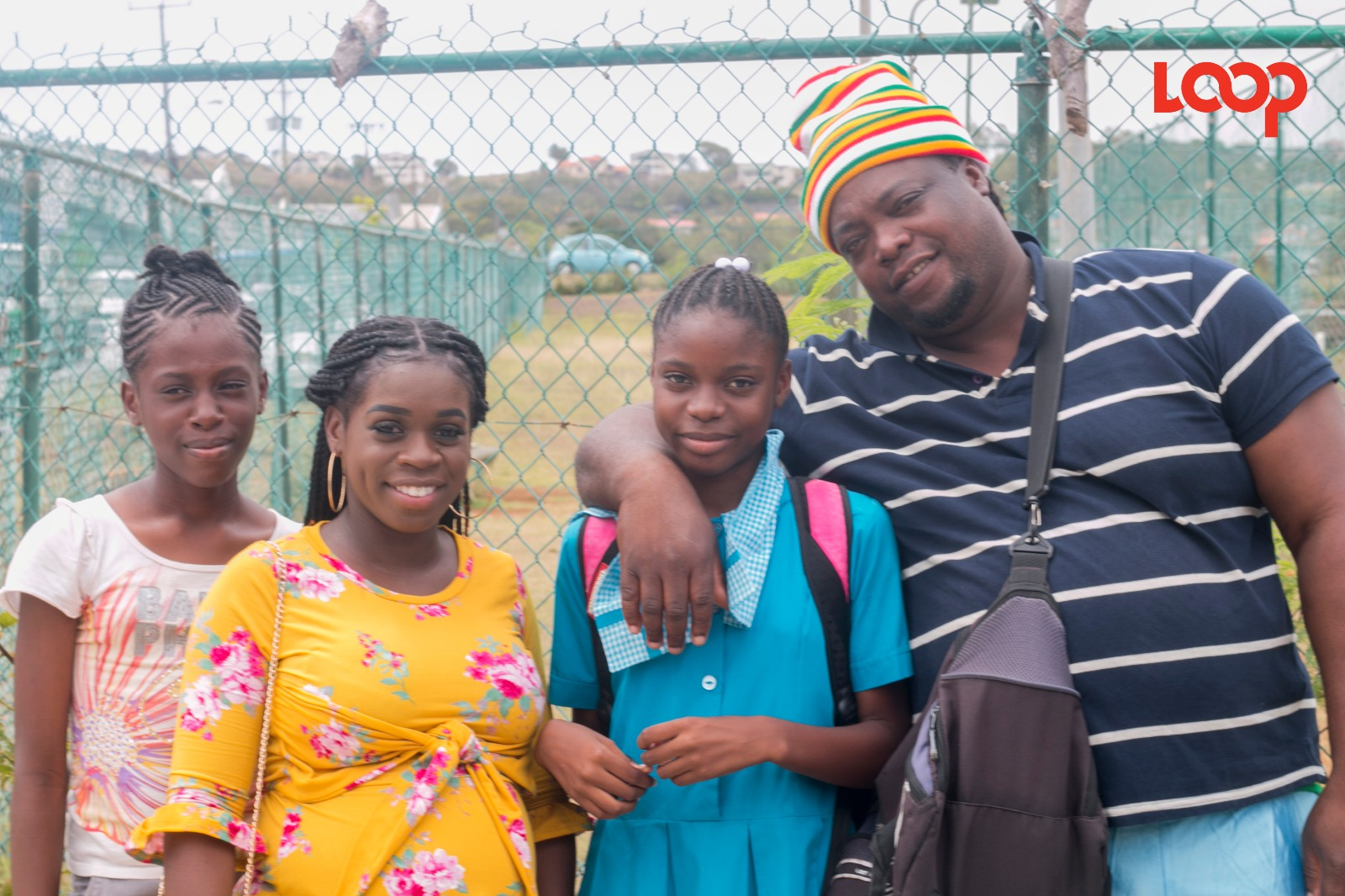 This family was photographed together outside Lester Vaughan Secondary School.