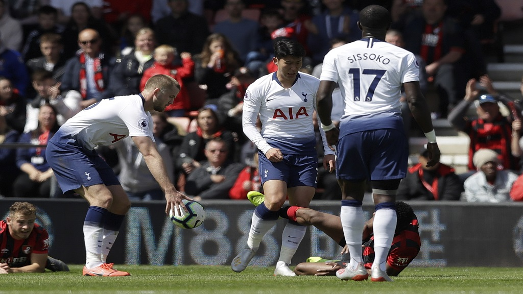 Tottenham's Son Heung-Min, centre, scuffles with Bournemouth's Jefferson Lerma, on the ground, during the English Premier League football match at the Vitality Stadium in Bournemouth, England, Saturday May 4, 2019. Son was shown a red card by Referee Craig Pawson.
