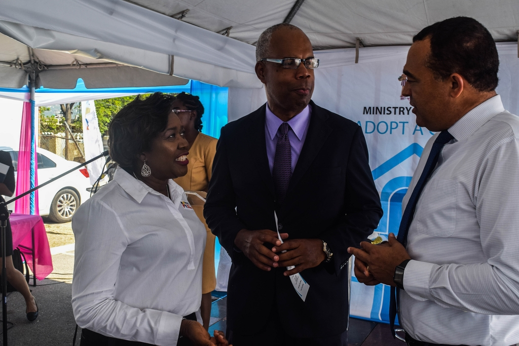(L-R) Winsome Gibbs, Country Manager for recently launched Massy United Insurance in Jamaica and Peter Graham, Country Manager for Massy Group (Jamaica) greet Minister of Health, Dr Christopher Tufton at the official ceremony to mark the adoption of the Seaview Gardens Health Centre in the community recently.