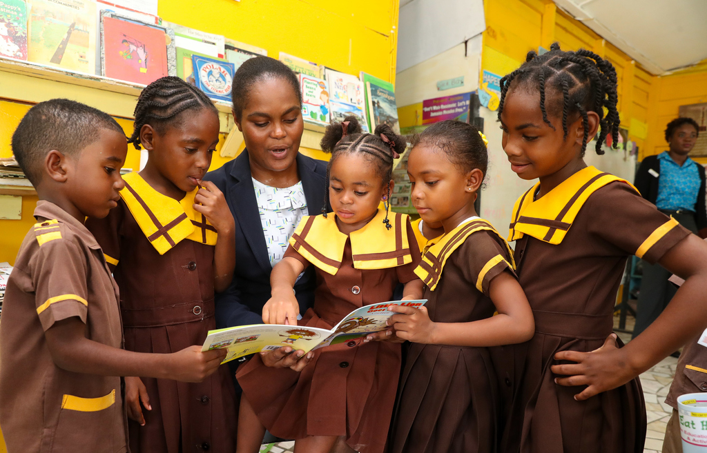 Sagicor volunteers engaged students with animated readings from locally authored children books.