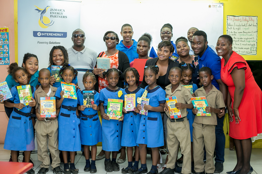 Students of Old Harbour Bay Primary pose for a photo op with the team from Jamaica Society for the Blind, Jamaica Energy Partners and West Kingston Power Partners.