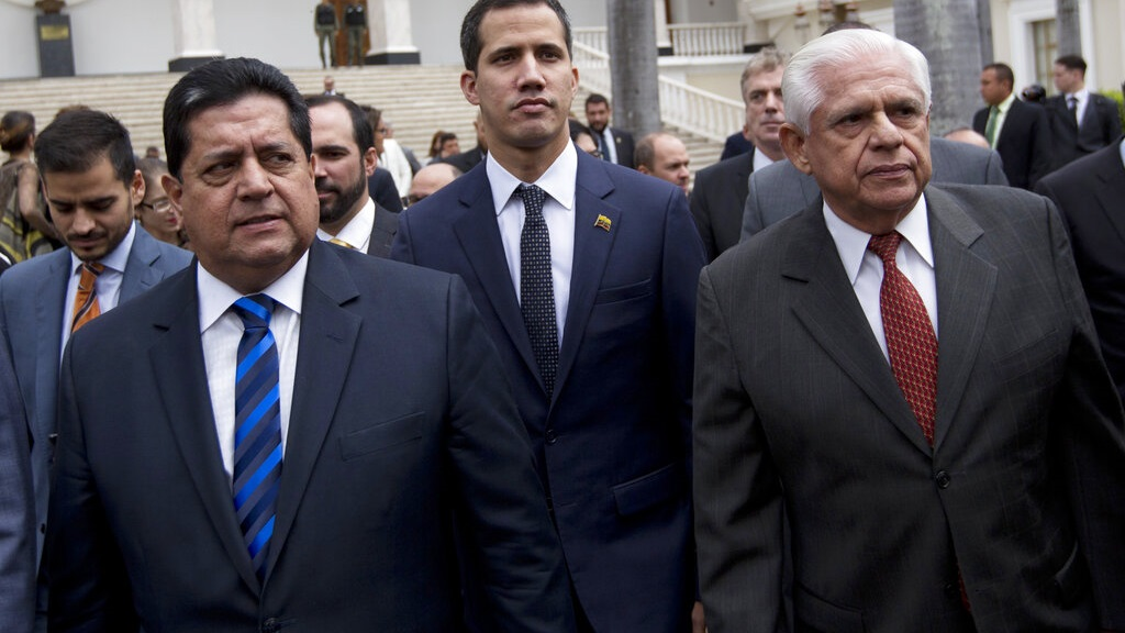 n this Jan. 5, 2019 file photo, incoming National Assembly Vice President Edgar Zambrano, left, arrives with incoming National Assembly President Juan Guaido, center, and Omar Barboza, outgoing president of Venezuela's National Assembly, to a special session at the Assembly in Caracas, Venezuela.  (AP Photo/Fernando Llano, File)