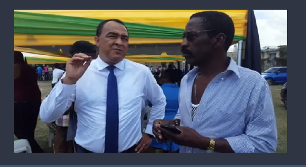 Health Minister, Dr Christopher Tufton (left), and former police traffic boss, Radcliffe Lewis, at a health sector event in Spanish Town last week.