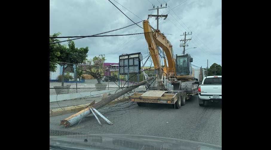 A broken light pole along Tom Redcam Drive in St Andrew on Wednesday.