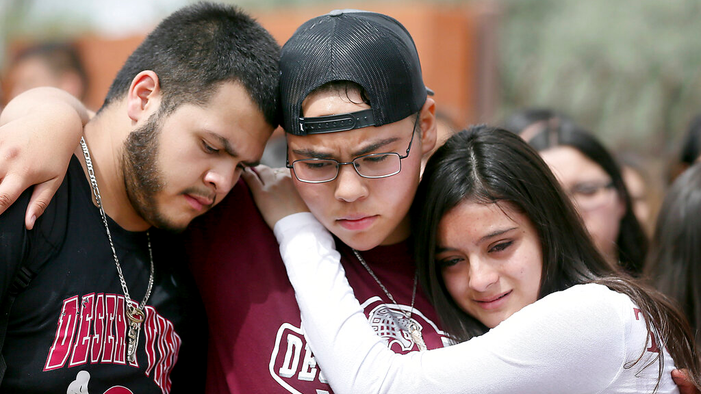 From left to right, Marcell Ibarra, 18, Daffne Anselmo, 16, and Jamilet Fragoso, 16, comfort each other after talking about their close friend Thomas Torres, a Desert View High School student who was taken into custody on May 2 by Border Patrol after a traffic stop by a Pima County Sheriff's Department deputy in Tucson, Ariz.(Mamta Popat/Arizona Daily Star via AP)