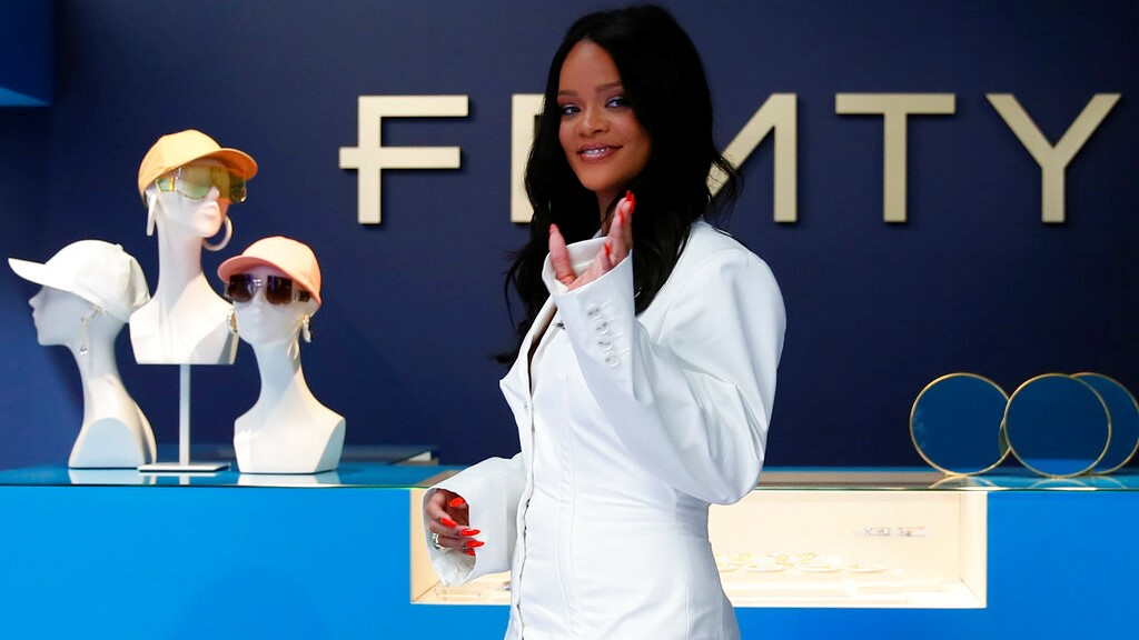 Rihanna poses as she unveils her first fashion designs for Fenty at a pop-up store in Paris, France, Wednesday, May 22, 2019. Singer Rihanna is the first black woman in history to head up a major Parisian luxury house, and the collection, named after the singer turned designer's last name, comprises of ready-to-wear, footwear, accessories, and eyewear and is available for sale Paris' Le Marais area from Friday and will debut online May 29. (AP Photo/Francois Mori)