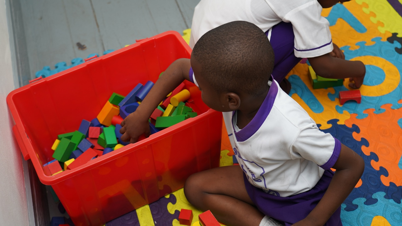 This youngster from Nadz Kidz Early Childhood Institution reached for the building blocks during Wednesday's play day at Deliverance Centre Basic School.