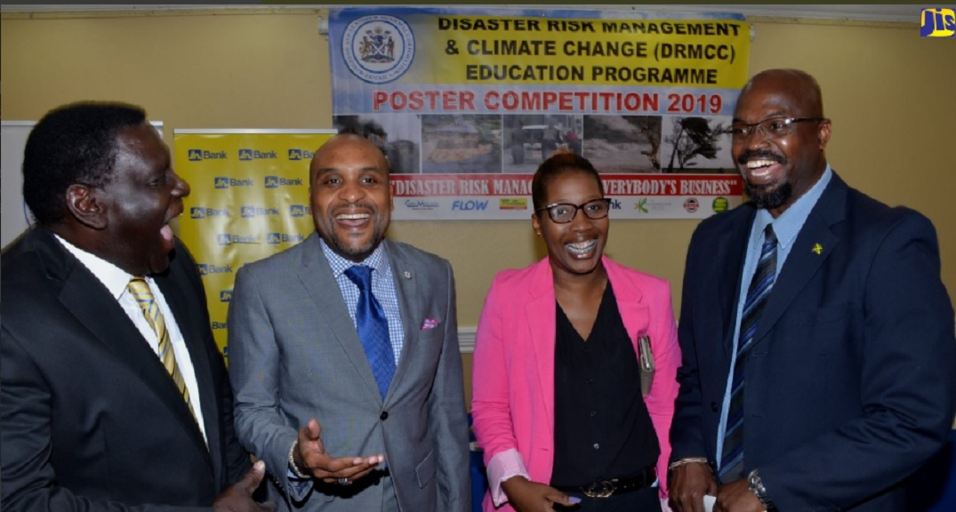 Chief Executive Officer of the Kingston and St. Andrew Municipal Corporation (KSAMC), Robert Hill (second left) shares a light moment with (from left) Opposition Spokesperson on the Public Health and Disaster Preparedness Committee at the KSAMC, Rev. Councillor Neville Wright (left); Kingston and St. Andrew Parish Disaster Coordinator, Terry Forrester; and the Acting Director General, Office of Disaster Preparedness and Emergency Management (ODPEM), Richard Thompson.