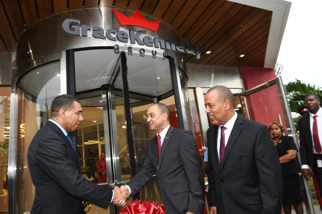 Prime Minister Andrew Holness (left) greets GraceKenendy Group CEO Don Wehby (centre) as GraceKennedy chairman Professor Gordon Shirley. (Photos by Marlon Reid)