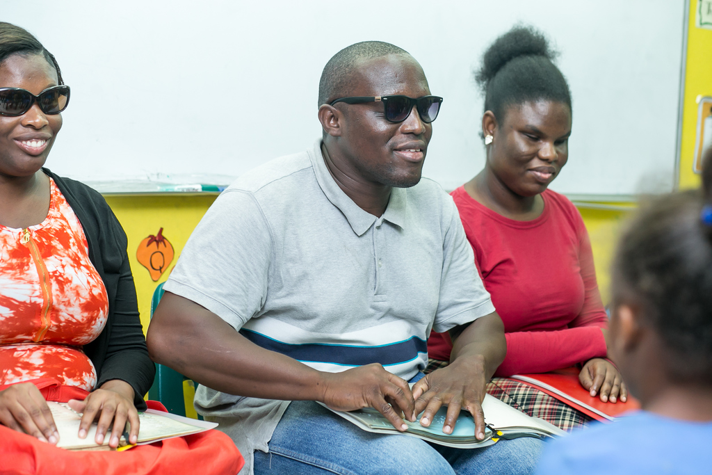 Damion Rose, Ayoki Sargeant and Jamie Lloyd all blind, used braille to read three different age-appropriate books to students of North Street Primary and Old Harbour Primary.