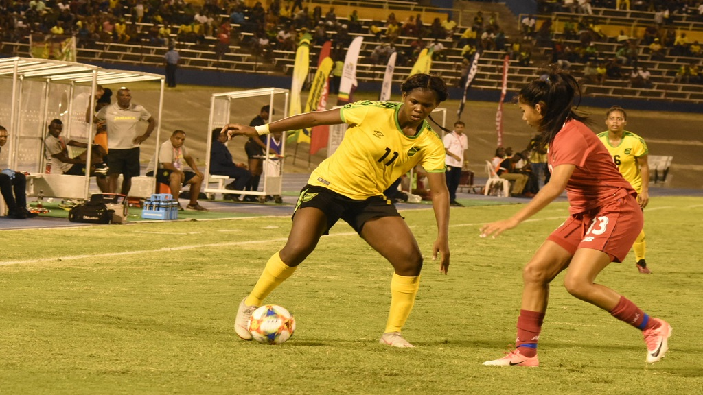 Reggae Girlz striker Khadijah Shaw (left) takes on Panama defender Rebeca Espinosa during their international friendly match at the National Stadium on Sunday, May 19, 2019. (PHOTOS: Marlon Reid).