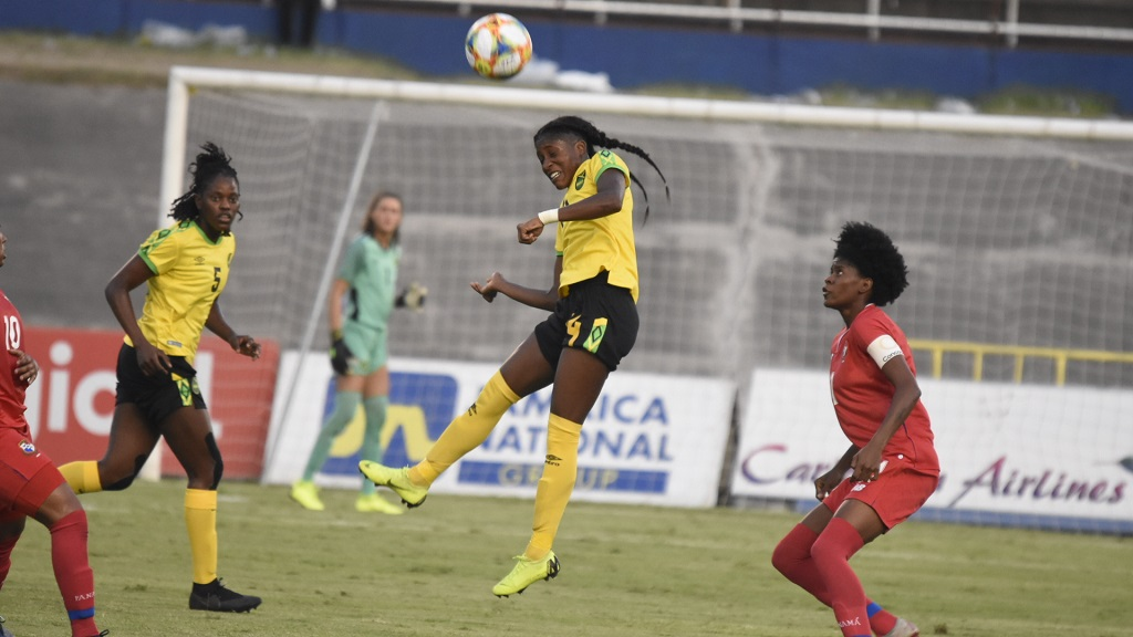 Jamaica's Deneisha Blackwood heads over the upright ahead of Panama's Natalia Mills (right), while Konya Plummer (left) watches during their international friendly match at the National Stadium in Kingston on Sunday, May 19, 2019. (PHOTO: Marlon Reid).