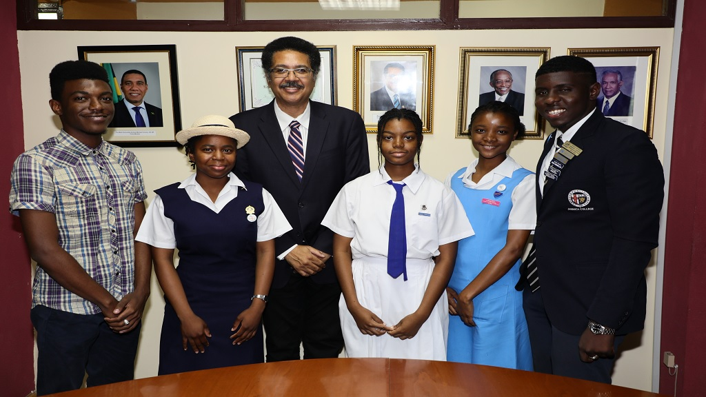 (From left) Adjaynae Billings, past student Ardenne High (3rd place winner, Essay Competition 2018), Wendy Ann Ivy, Westwood High School(2nd place Public Speaking Competition 2019), Professor Stephen Vasciannie (President UTech), Lorena Eschoe, Immaculate Conception High (3rd place Public Speaking Competition 2019), Ruwenzori Ra, Ardenne High School (2nd place Essay Competition 2018), and Fabian Morris, JC (1st place Public Speaking Competition 2019).