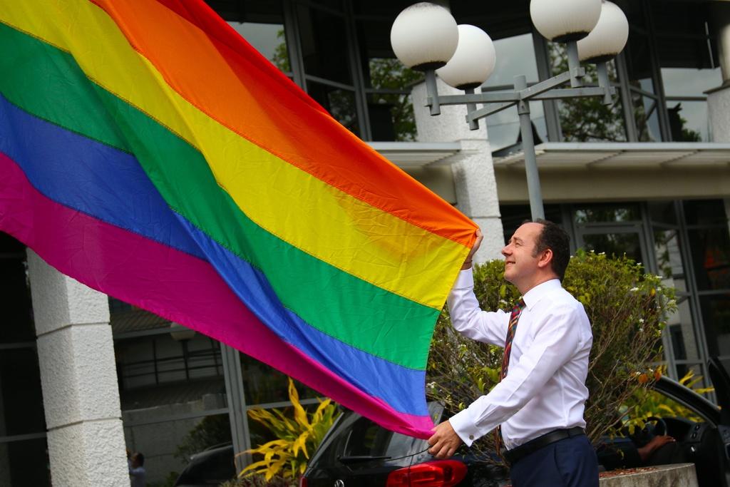 British High Commissioner Tim Stew raises the rainbow flag for International Day Against Homophobia, Biphobia & Transphobia (IDAHOBIT)